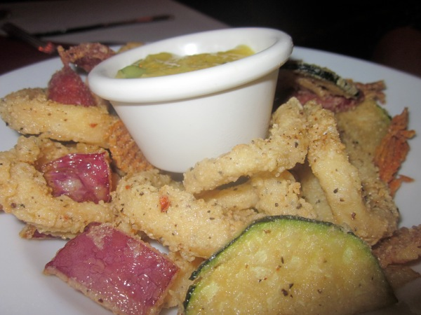 Coco Loco Caribbean Calamari $11.9 Coconut milk dredged flour dusted tubes, chorizo & squash with a  roasted garlic aïoli.